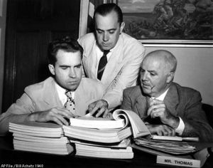 Red hunting at HUAC: A staged photo of Rep. Richard Nixon, R-CA, investigator Robert Stripling, and Rep. J. Parnell Thomas, R-NJ, left to right, over transcripts of  testimony in the House Un-American Activities committee spy inquiry August 26, 1948, preparatory to turning it over to the Justice Department. (AP Photo/Bill Achatz)