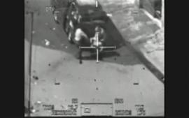 In the cross-hairs of an Apache gun: This image captured from a classified U.S. military video footage shows a wounded Iraqi person being loaded onto a van during a 2007 attack by Apache helicopters that killed a dozen people in Baghdad, including two Reuters news staff on July 12, 2007, and released to Reuters on April 5, 2010 by WikiLeaks, a group that promotes leaking to fight government and corporate corruption. Reuters photographer Namir Noor-Eldeen, 22, and his assistant and driver Saeed Chmagh, 40, were killed in the incident. The helicopter initially opens fire on the small group. Minutes later a van comes by, and starts assisting the wounded, and the helicopter opens fire on the van. From video leaked to Wikileaks.