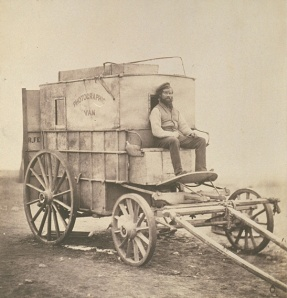 Roger Fentons Photographic Van (Salted Paper Print. ca. 1855. Royal Photographic Society Collection.) Fenton was sponsored and equipped by the British Government to document the Crimean War. That war was exceedingly unpopular among the public and Fenton, as a result, avoided scenes of death, which would shortly become a staple of independent war photojournalists. Click to enlarge.