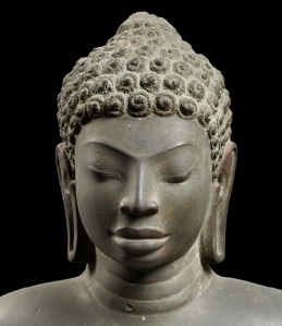 Detail of early 7th Century C.E. Buddha (Sandstone.National Museum of Thailand.) Click to enlarge.