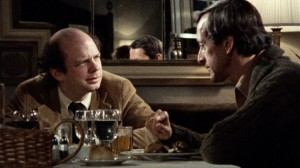 "Much younger Wallace Shawn and Andre Gregory discuss the meaning of life over an elegant dinner in ""My Dinner with Andre."""