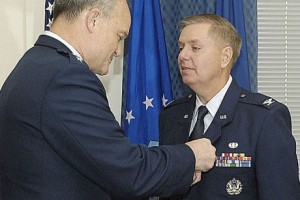 Colonel Lindsey Graham receives Meritorious Service Medal from Air Force judge advocate general  on April 28, 2009.