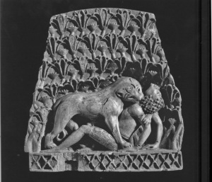 Plaque with lioness mauling young male from Northwest Palace, Room MM, Nimrud. (Ivory, gold, semiprecious stones. 9th-8th Centuries B.C.E. British Museum.)