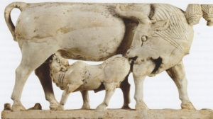 Ivory open work cow with calf from Arslan Tash. (Ivory and gold. 8th century B.C.E. The Louvre.)