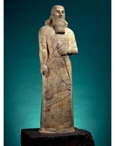 Ashurnasirpal II from Ishtar Sharrat-niphi temple, Nimrud (Magnesite on reddish stone. ca. 875-860 B.C.E. British Museum.)