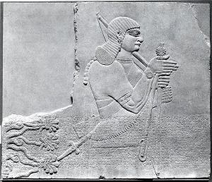 Attendant from Room L of the Northwest Palace in Nimrud (location 4 in #15, above). (Gypsum alabaster. ca. 883-859. Metropolitan Museum of Art.)