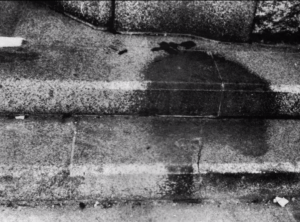 On the steps outside Sumitomo Hiroshima Bank, Kamiya-Cho, 850 feet from the epicenter on August 6, Mitsuno Ochi (1903-August 6, 1945) sat with one leg crossed over another. In a moment she evaporated, leaving only a shadow. (United States Strategic Bombing Survey (USSBS) photo, December 31, 1945. National Archives.)