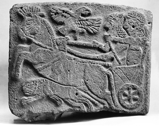 47. *Relief of lion hunting scene from Tell Halaf. (Basalt. ca. 9th century. Metropolitan Museum of Art.)