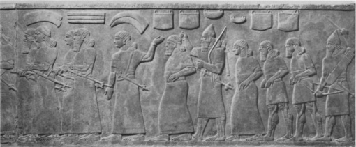 23. *Train of Prisoners from Throneroom of Northwest Palace in Nimrud. (Gypsum alabaster. 883-859 B.C.E.)