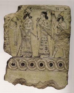 Tile fragment of King (Ashurnasirpal II?) with attendants from Northwest Palace, Nimrud. (Glazed ceramic. 9th Century B.C.E. British Museum.)