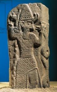 Stele of Tukulti-Ninurta IIs defeating Araean-Hittites at Lakē from Tell Ashara Terqa on the Euphrates. Basalt orthostat. mid-9th Century B.C.E. Aleppo National Museum.)