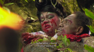 Koto, again in drag, this time as an avenging angel of nightmares, confronts Congo, who plays the victim he beheaded.