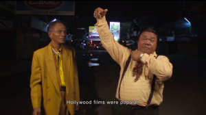 Anwar Congo (l) and Herman Koto (r) discuss why their film should be more popular than Nazi films: because they can make theirs more sadistic.