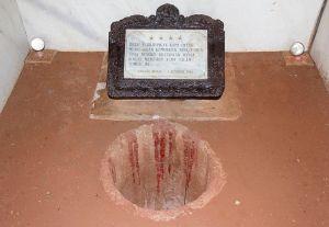 The Sumur Maut at Lubang Buaya. (Photo: Chris Woodrich; CC license via Wikimedia.) The marker says