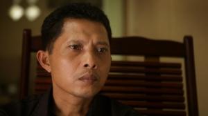 Adi Rikun watching video of his brothers' killers describing the deed.