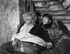 Falstaff and Hal in bed after Poins has picked Falstaff's pocket (and given the contents of Hal).