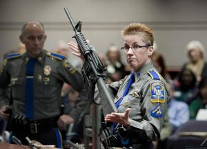 Bushmaster AR-15 rifle, the same make and model of gun used in the Sandy Hook School shooting, displayed by Connecticut State Police officer in 2013.