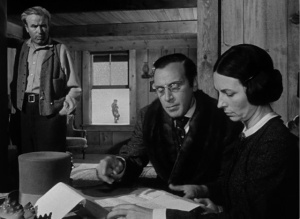 As Mary Kane signs the papers transferring her son to the banker Thatcher, her husband looks on impotently and Charles is seen through the window in happy ignorance.